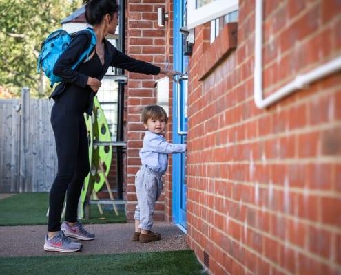 Boy pushing on door